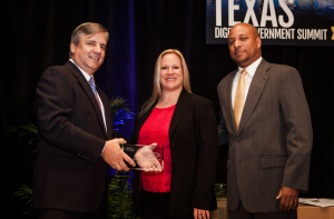 Lt. Kimberly Owens and Cornell Perry accept the 2014 Best of Texas Award on behalf of the Dallas Police Department